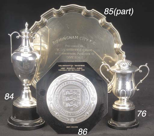 A miniature silver replica of