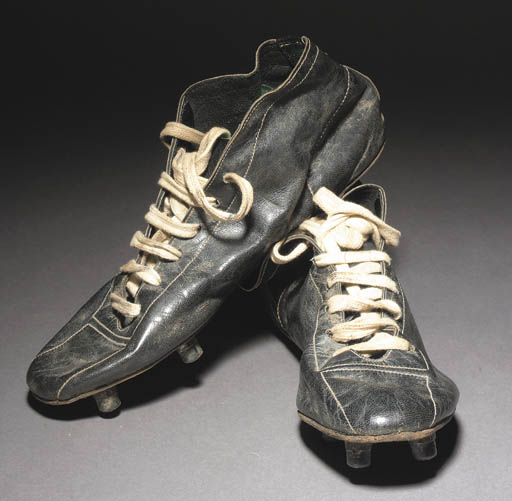 A pair of black leather footba