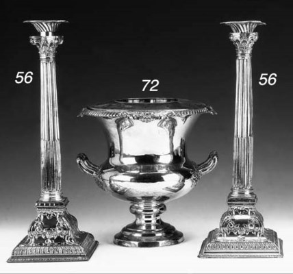 A PAIR OF PLATED CANDLESTICKS