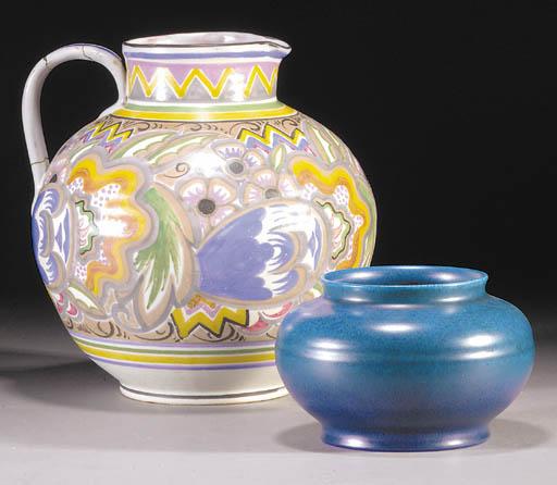 A CSA Poole Pottery jug