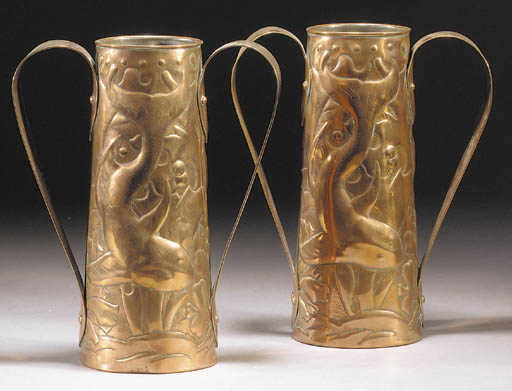 A pair of copper twin-handled