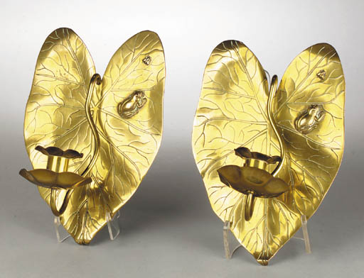 A pair of Aesthetic brass wall
