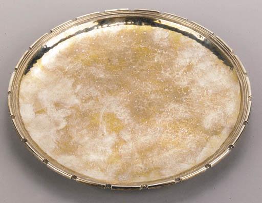 An Omar Ramsden silver circula