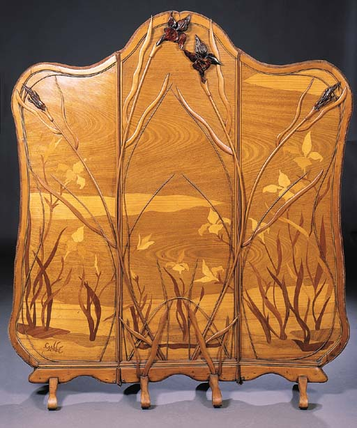 A CARVED MARQUETRY SCREEN BY E