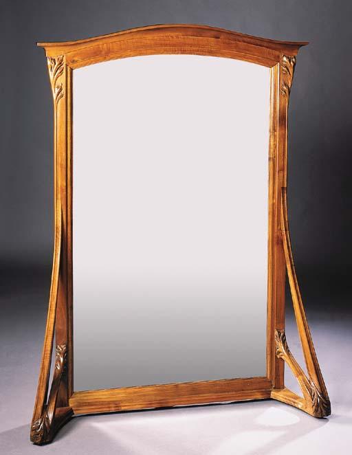 A CARVED WALNUT MIRROR-GLASS,