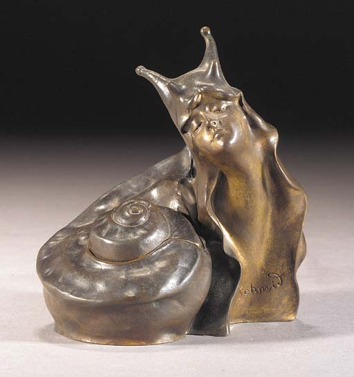 A PATINATED BRONZE INKWELL