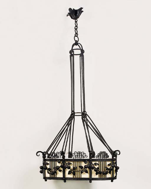 A wrought iron chandelier, ear