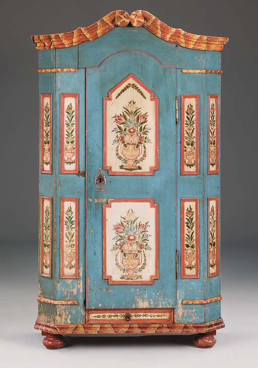 A TYROLEAN DECORATED CUPBOARD,
