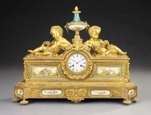 A French gilt bronze and porce