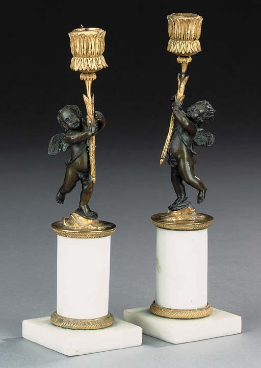 A pair of Directoire gilt and