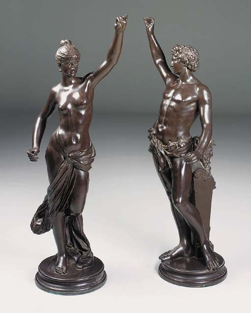 A pair of patinated bronze ele
