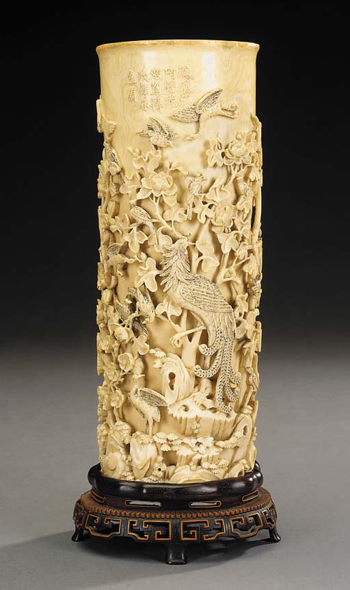 An Oriental carved ivory vase,