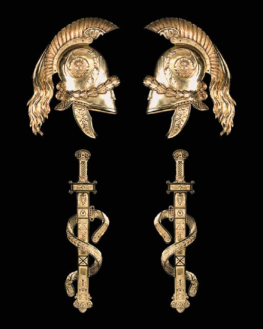 A pair of gilt bronze trophy w