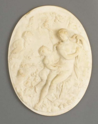 A sculpted white marble oval p