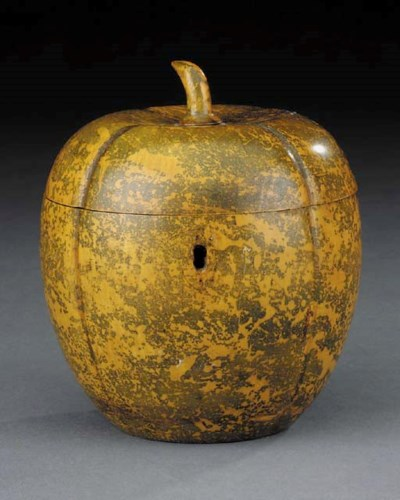A stained carved fruitwood tea