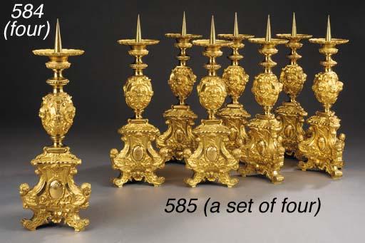 A set of four gilt bronze pric