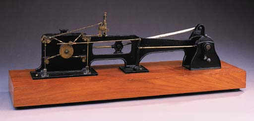 A cast iron and brass cutaway