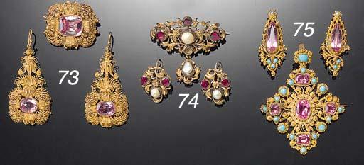 An antique gold and gem brooch