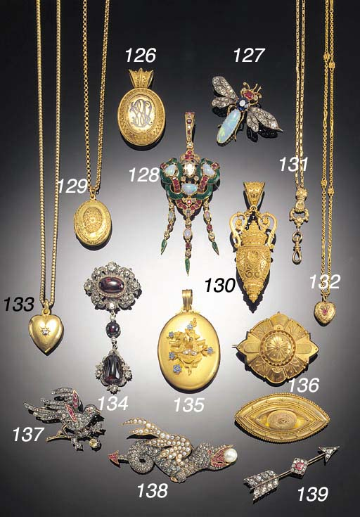A group of gold locket pendant