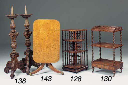 A mahogany three tier revolvin