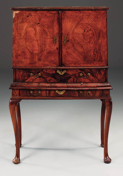 A walnut, crossbanded cabinet-