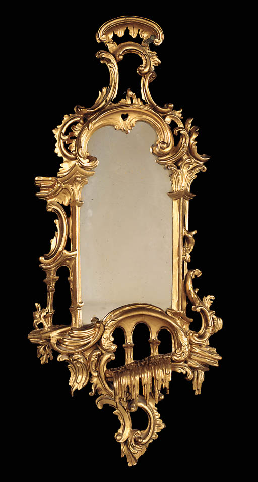 A small carved giltwood mirror