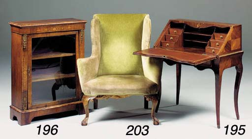 A walnut and green upholstery