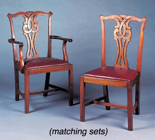 A set of twelve mahogany dinin