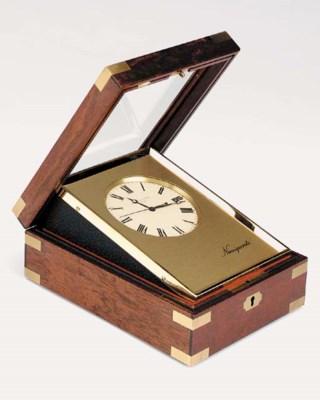 A Swiss Naviquartz desk chrono