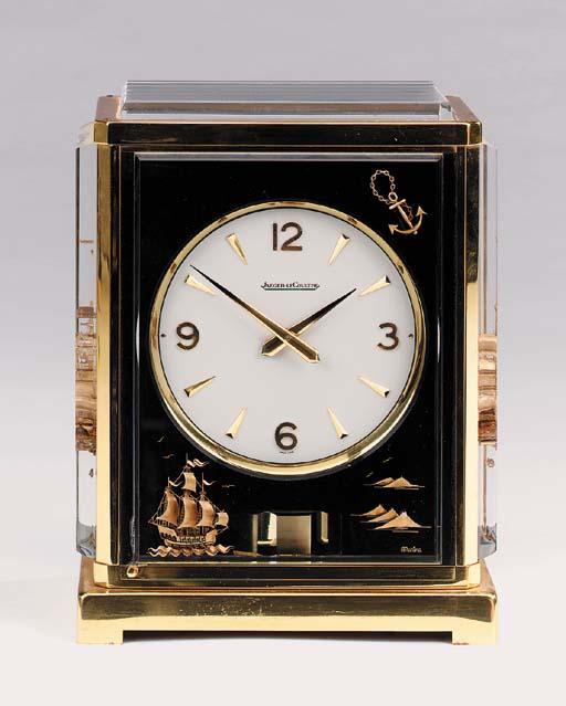 A Swiss brass Atmos clock, cir