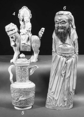 An ivory Guanyin and lion grou