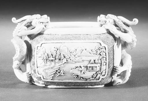 An ivory twin-handled cup 20th