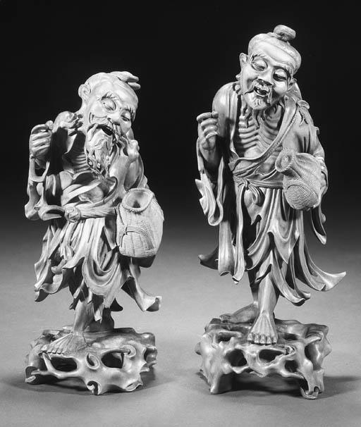 A pair of wood emaciated figur