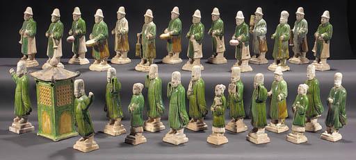 A pottery group of twenty eigh