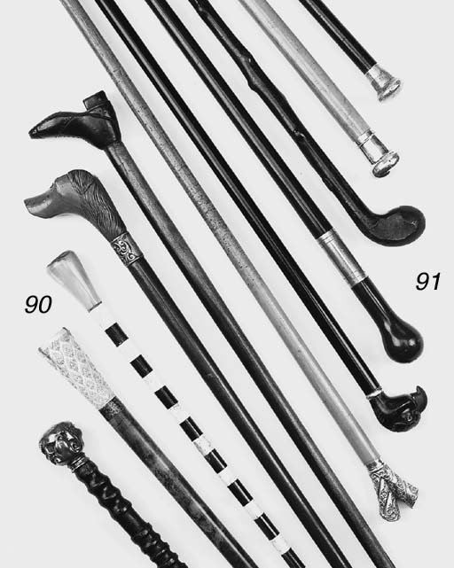 A large collection of canes an