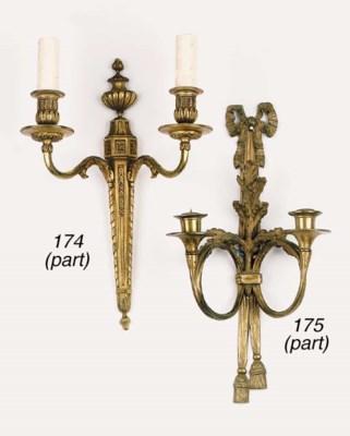 A set of four gilt brass twin