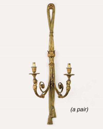 A pair of Continental gilt bra