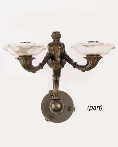 A set of four bronze twin ligh