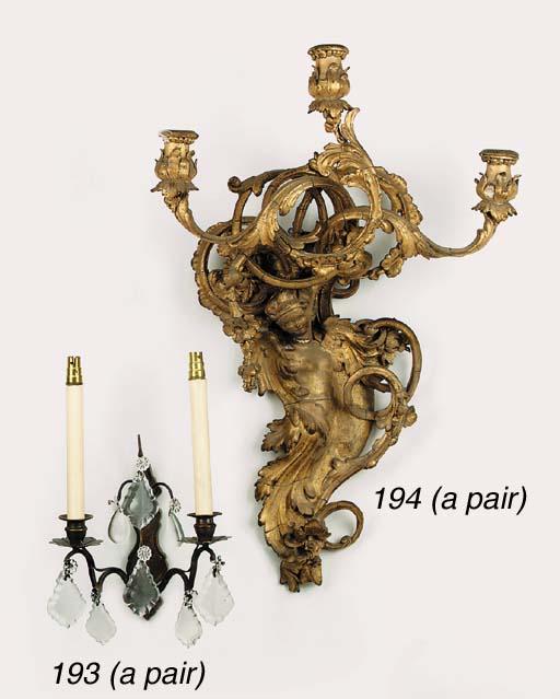 A pair of English gilt composi