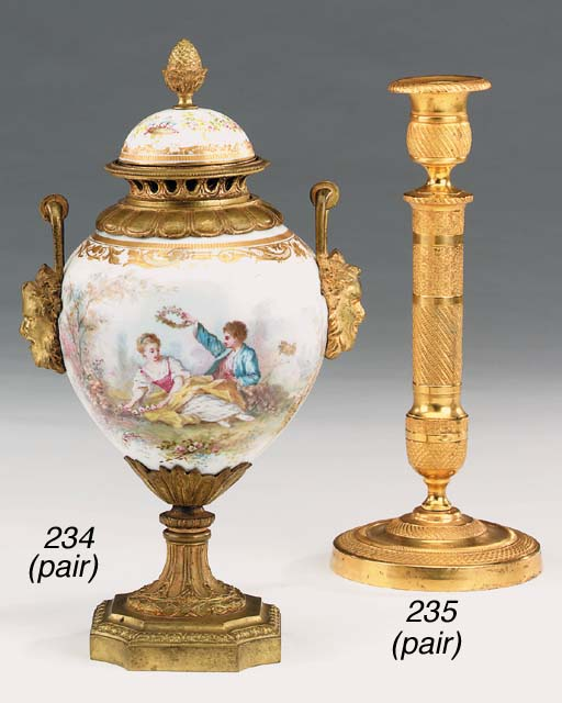A pair of Empire style gilt br