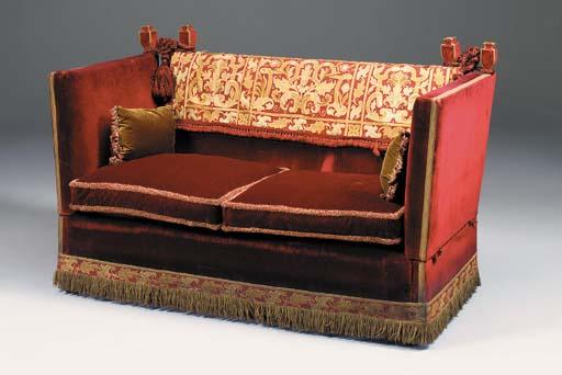A red velvet and tapestry upho
