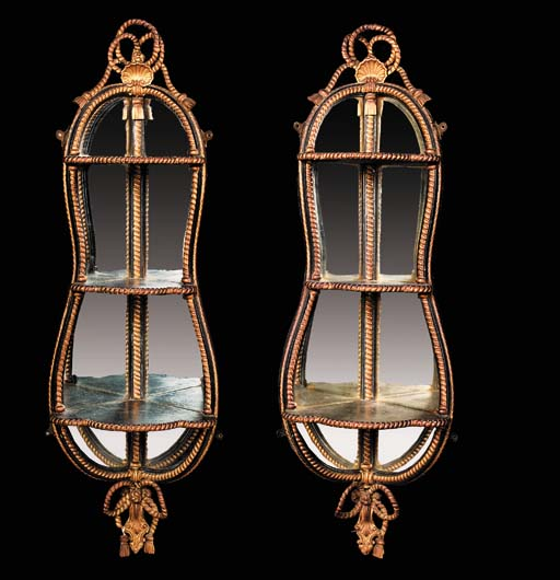 A pair of ebonised and gilded