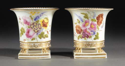 A pair of English porcelain fl