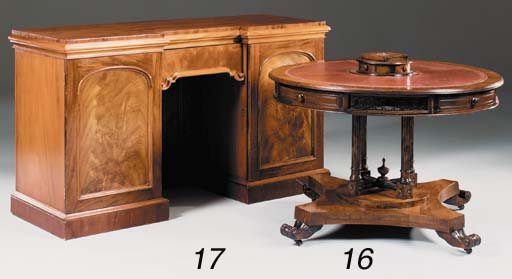 A mahogany rotating drum table