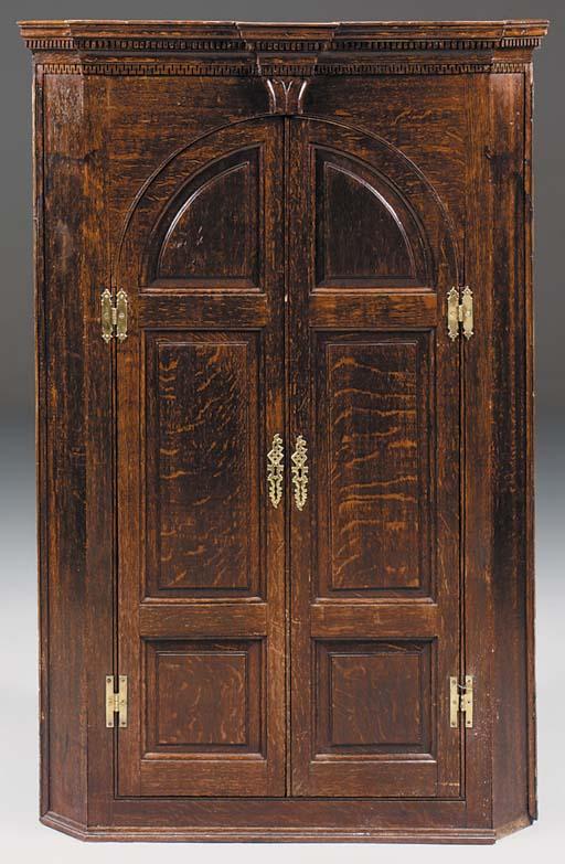 An oak corner cupboard, late 1