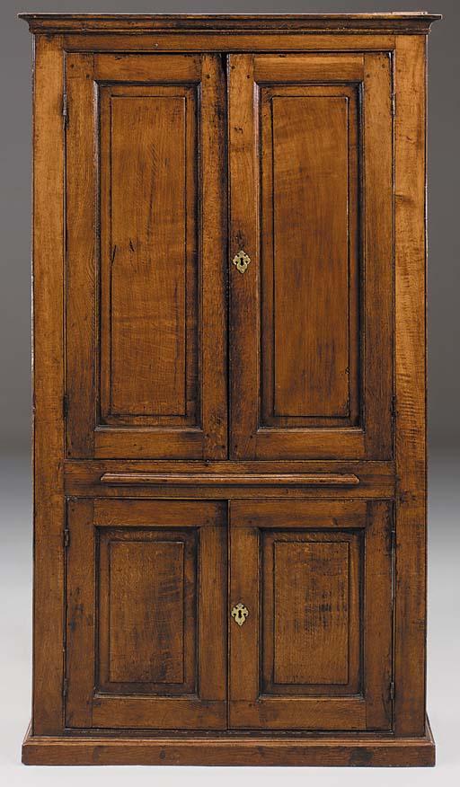 A free standing oak cupboard,