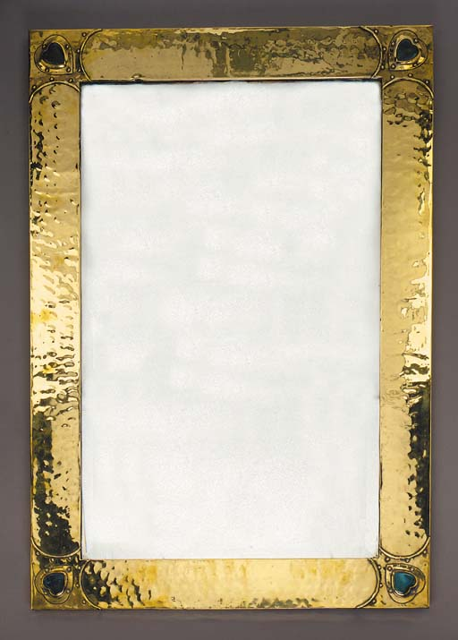 A BRASS RECTANGULAR WALL MIRRO