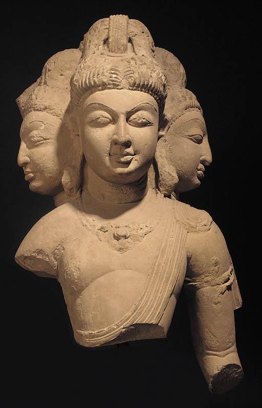 A large Indian stone figure mo