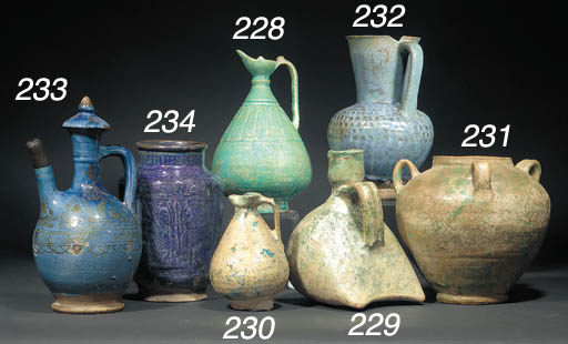 A turquoise glazed pottery ewe