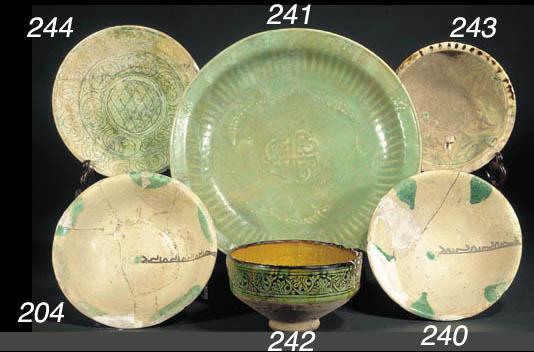 An Islamic green glazed dish 1